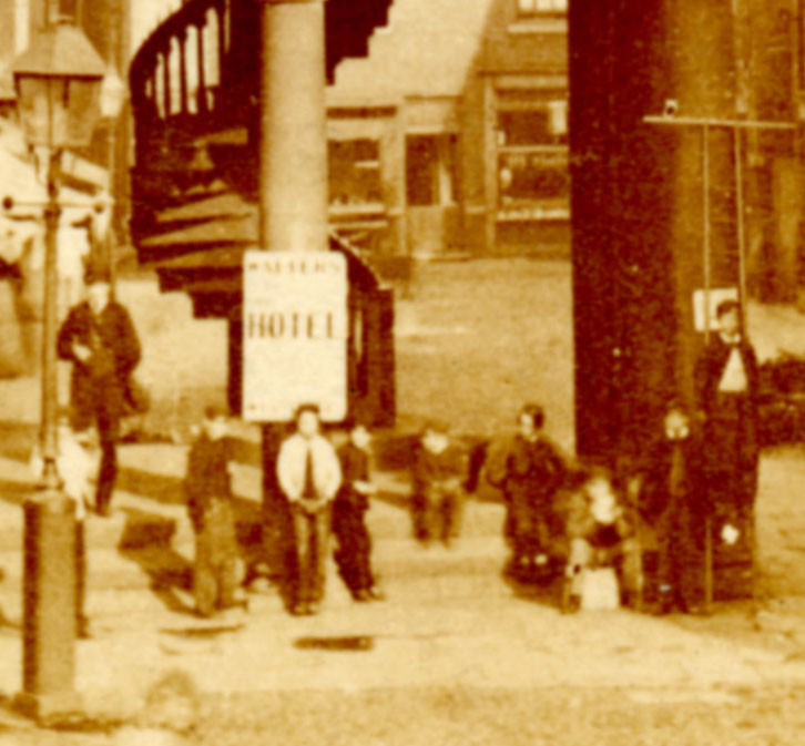 Wakefield's street urchins gathering at the Butter Cross. Was that ladder used by the town's lamp-lighter?