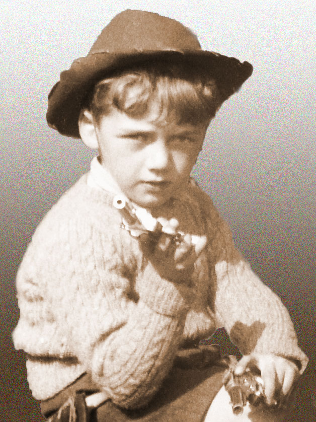 Richard as a cowboy, aged about 5 or 6.